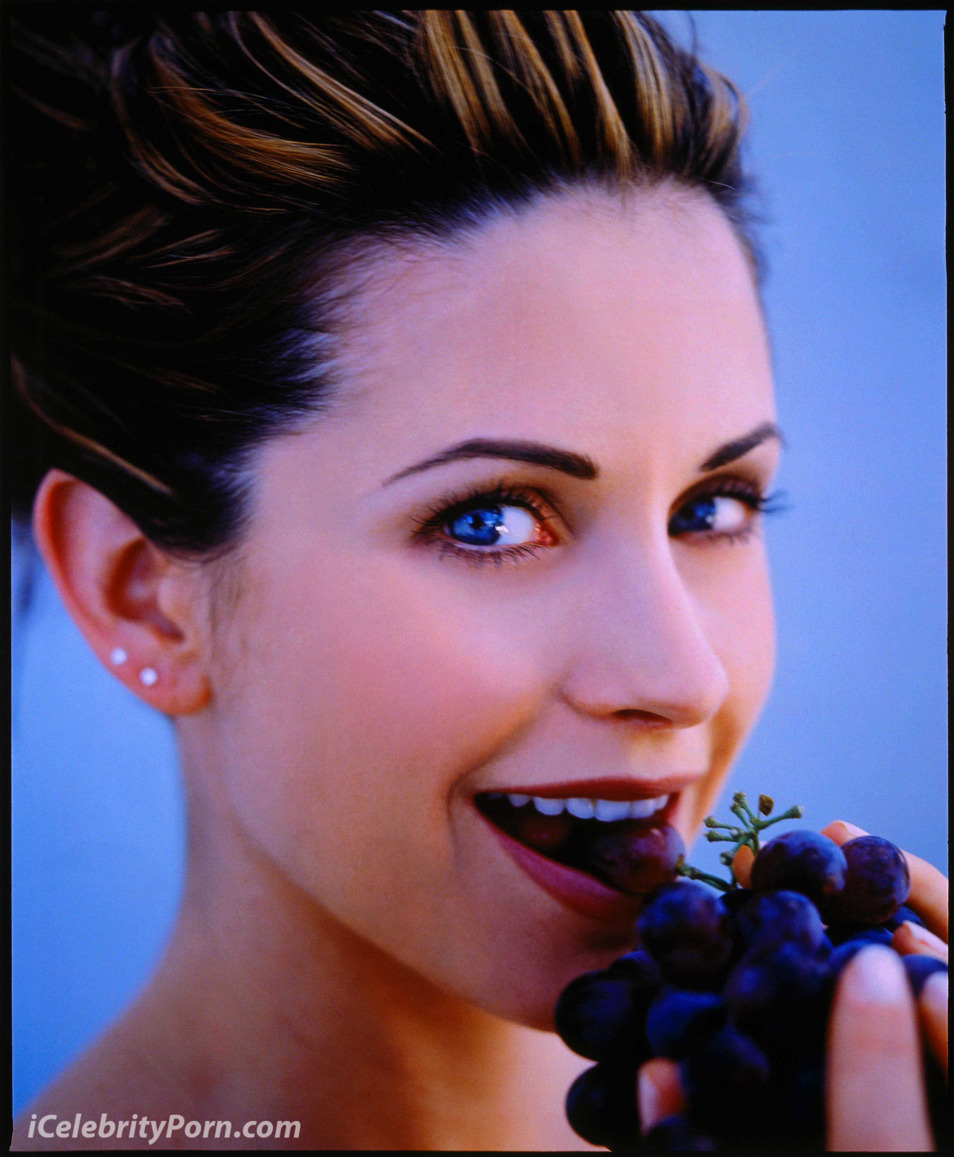 01 Jul 1996 --- Courteney Cox Eating Grapes --- Image by © Mark Seliger/CORBIS OUTLINE